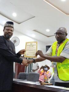 Chris Isiguzo receiving certificate of return