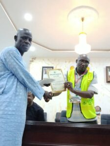Abdul Rasaq Alege, the newly elected B Zone Secretary receiving his certificate of return