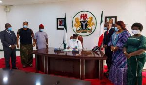 Governor Ifeanyi Ugwuanyi of Enugu State assenting the budget
