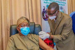 Oyetola receiving COVID-19 vaccine